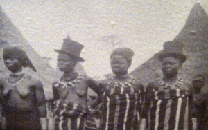 "Detail: ""The favourite wives of Chief Towai, wearing imported Western top hats, 1929. Courtesy of the Peabody Museum of Archeology and Ethnology, Harvard University."