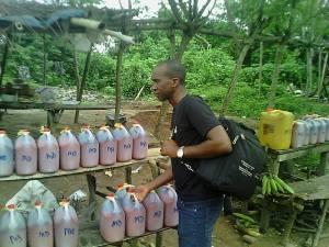 Buying palm oil in Owo, SW Nigeria