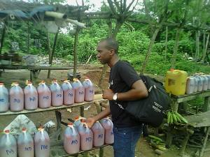Buying palm oil in Owo, SW Nigeria