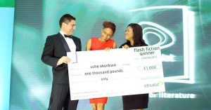 Uche Okonkwo receives her cheque as winner of the Etisalat Flash Fiction Prize