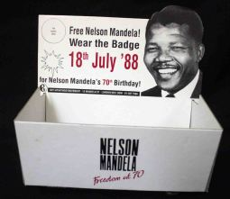 Display box for the badge produced for the 'Nelson Mandela Freedom at 70' campaign. The AAM aimed to get 1,000,000 people in Britain wearing the badge on Mandela's 70th birthday, 18 July 1988.