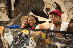 Zoleka, Veronica and Nombulelo with banner close up 6x4