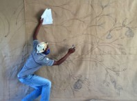 Keiskamma Art Project artist Siyabonga Maswana bringing the sacred fig tree to life on the hessian canvas of the COVID-19 Resilience Tapestry.